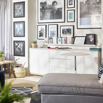 ikea white storage unit in living room with grey chaise armchair