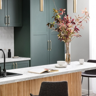 kaboodle kitchen dark green kitchen cabinets with gold brass handles and white marble countertop