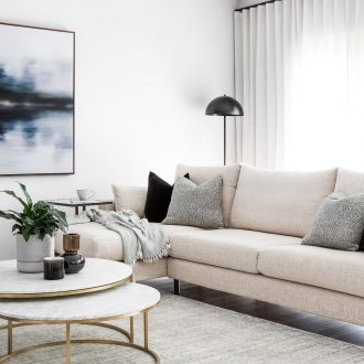 luxe living room with moody abstract art and white sofa