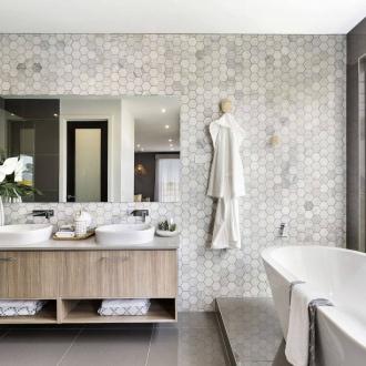 metricon bathroom with marble mosaic tiles beige and grey bathroom freestanding bath