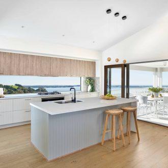 metricon coastal kitchen with vj panel cabinets and glass window splashback