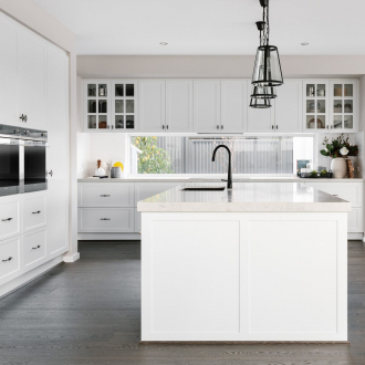 metricon white hamptons kitchen with shaker style cabinets and black handles