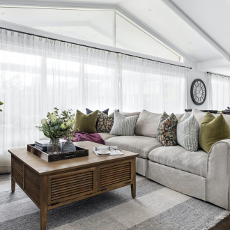 modern country living room with slip cover sofa and rustic timber coffee table