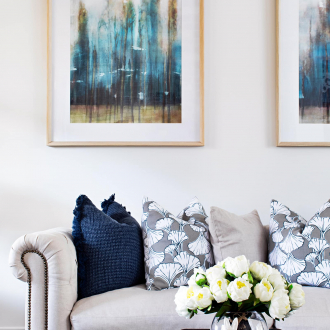 modern provincial living room with beige provincial sofa and blue and white cushions