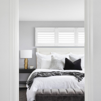 monochromatic master bedroom design with heatherley designs bedhead gold bedside table lamp and plantation shutters