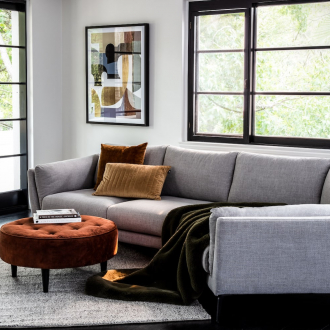 oz design angled sofa in urban interior design style living room dark floors white walls