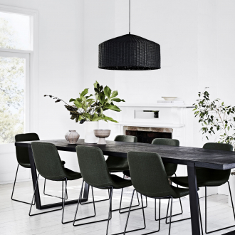 sadie black woven rattan pendant over long dark dining table globewest