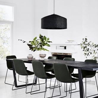sadie black woven rattan pendant over long dark dining table globewest