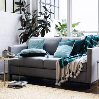 sheridan grey sofa in living room with white brick wall
