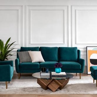 teal velvet sofa with gold legs in living room