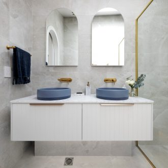 the block 2021 kirsty and jesse master ensuite white floating vanity with blue round basins and brass taps